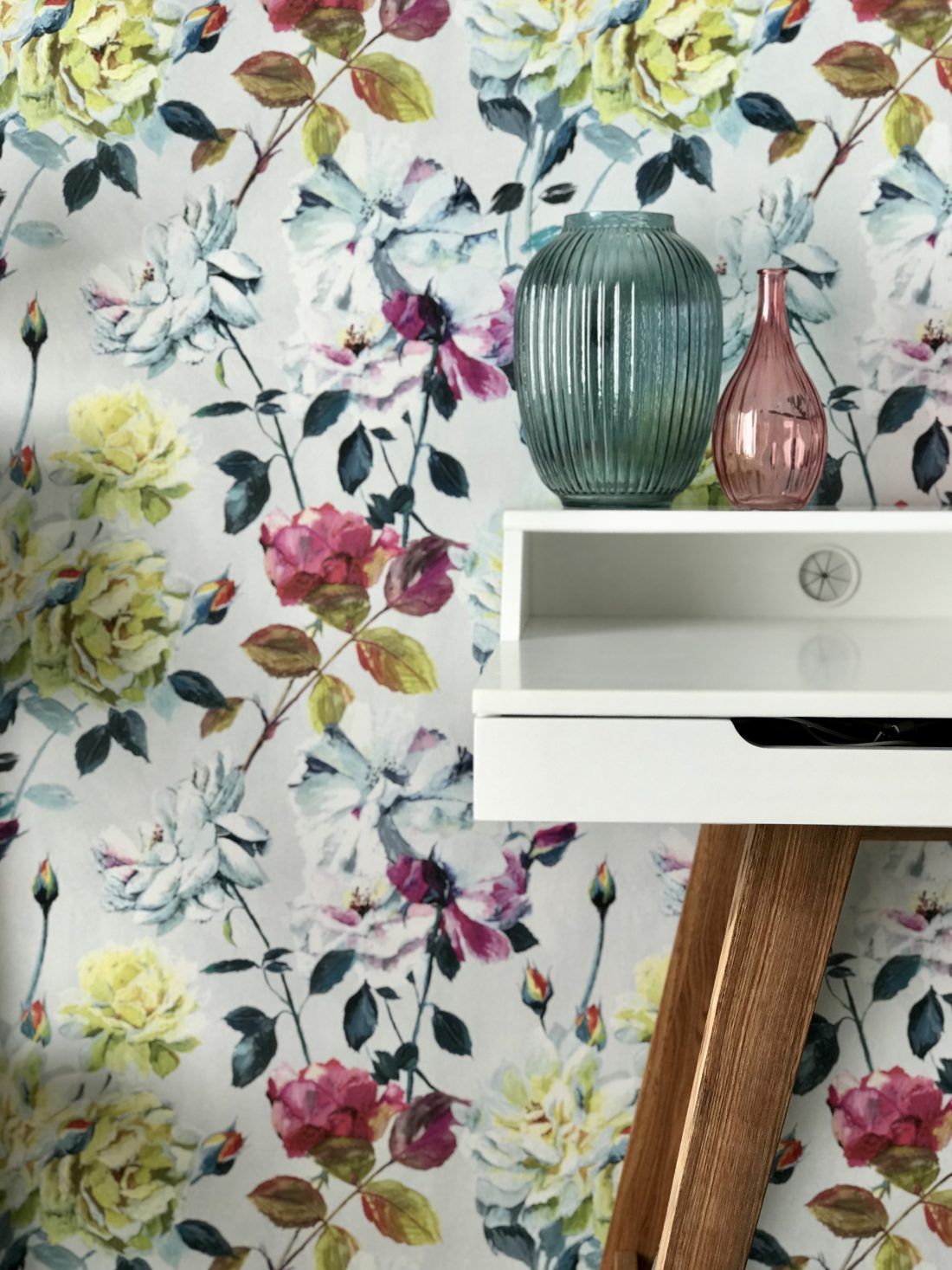 Office desk with colourful floral wallpaper feature wall